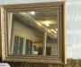 A suornate gold frame mirror
